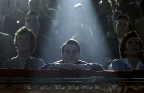 Still from the film showing an audience sitting in a movie theater.