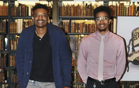 Two interns from New haven Promise program working at Beinecke Library
