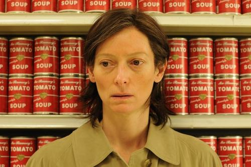 film still showing a close-up of Tilda Swinton in a grocery store