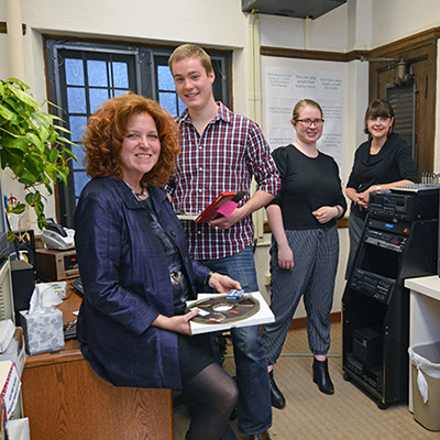 OHAM Director Libby Van Cleve with student workers in her office