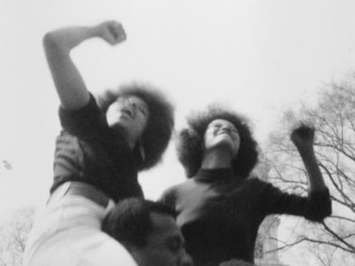 Two women raise their fists in Black Power salutes at the 1970 Mayday protests