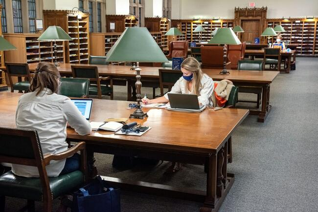Two girls studying in the Periodical Reading room