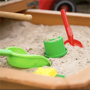 plastic spades and containers in a sandbox