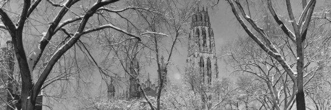 View of the top of Harkness Tower on a snowy day.