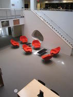 Basement level of the Robert B. Haas Family Arts Library with chairs designed by Eero Saarinen