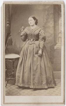 Black and white carte-de-visite, woman with small bird,