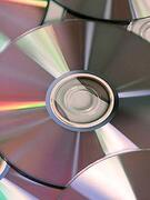 A pile of CD-Rom facing up