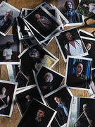 photo portraits of women scattered on a table top