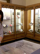 "Elizabeth Morris installing 2016 ""Moving Earth"" exhibit in Memorabilia Room"