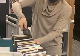 University Librarian Barbara Rockenbach scans books