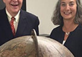 Stephen F. Gates '68 and Susan Gibbons are pictured in 2015 with one of Yale's rare 1699 Vincenzo Coronelli globes.