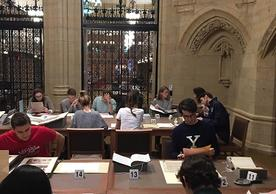 Students in HIST 134J, Yale and America, exploring Manuscripts and Archives collection materials in the new Gates classroom.