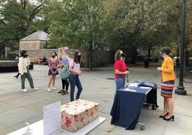Students wait in line to write postcards for the University archives