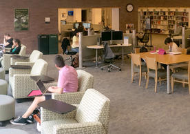 Marx Library Study Room West -- includes soft seating, large tables, power outlets, and public computers