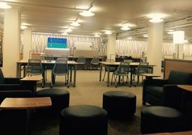 Marx Library lower level has over 60 seats, books, a seminar room, and contemporary map collection