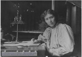 Rose Pastor Stokes (1879-1933), political activist and author, at her desk in her New York City apartment. Rose Pastor Stokes Papers (MS 573), Box 10, Folder 20.