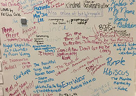 whiteboard surface covered with handwritten book titles