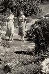 Beatrix Farrand walking in the gardens she landscaped at Yale