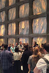 Crowd of students with Beinecke Library director inside the library